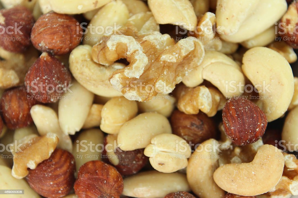 Image of mixed nuts close-up, almonds, cashews, hazelnuts and walnuts stock photo