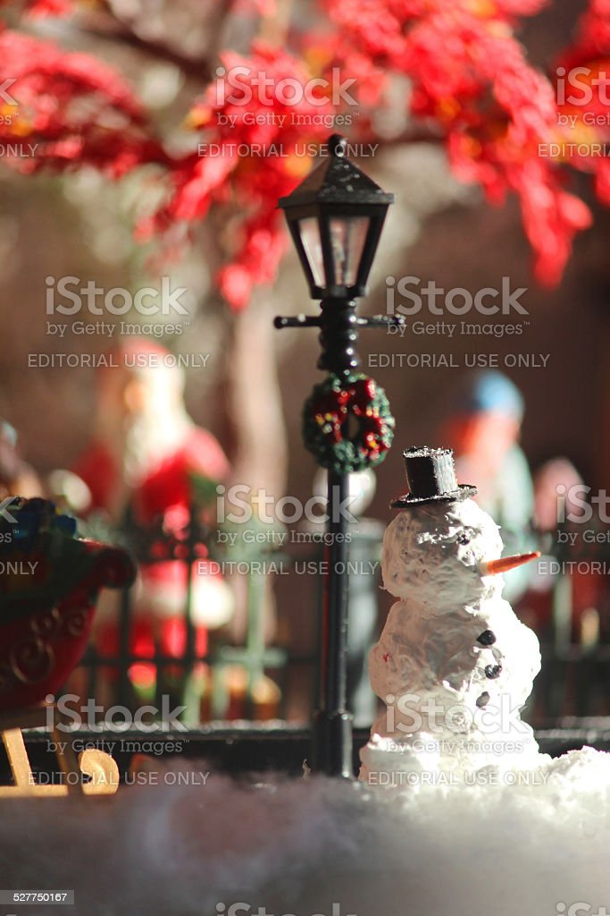 Image of model Christmas village with homemade snowman, people, winter-scene stock photo