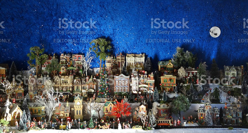 Image of model Christmas village with miniature houses, people, winter-scene stock photo