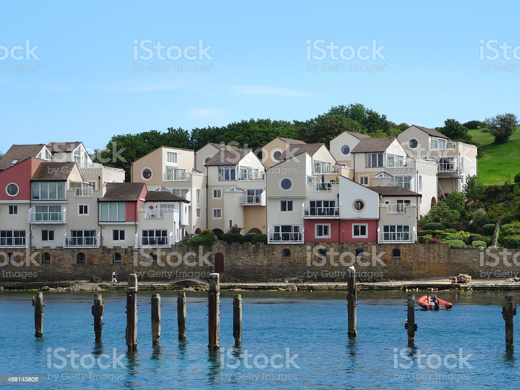 Image of modern coastal houses overlooking seafront and old pier stock photo