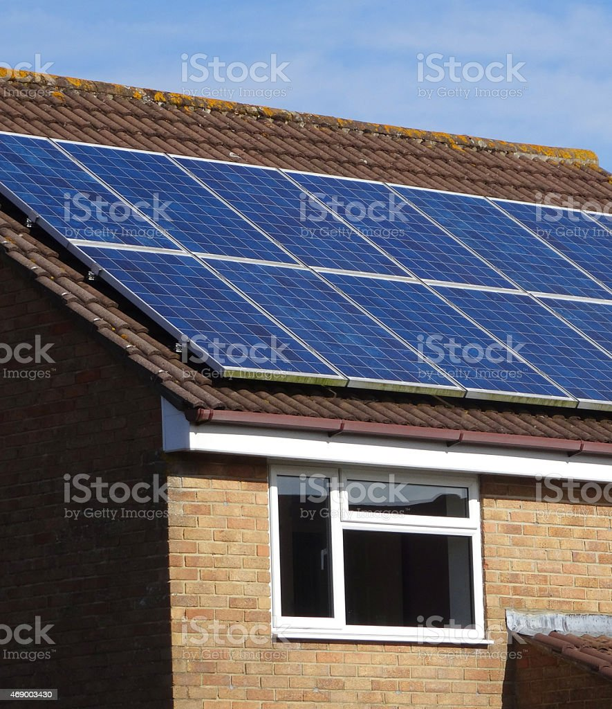 Image of modern house with solar panel cells on roof stock photo