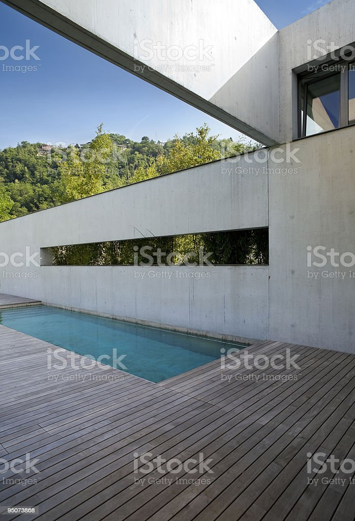 Image of modern minimalist home exterior showing a pool  royalty-free stock photo