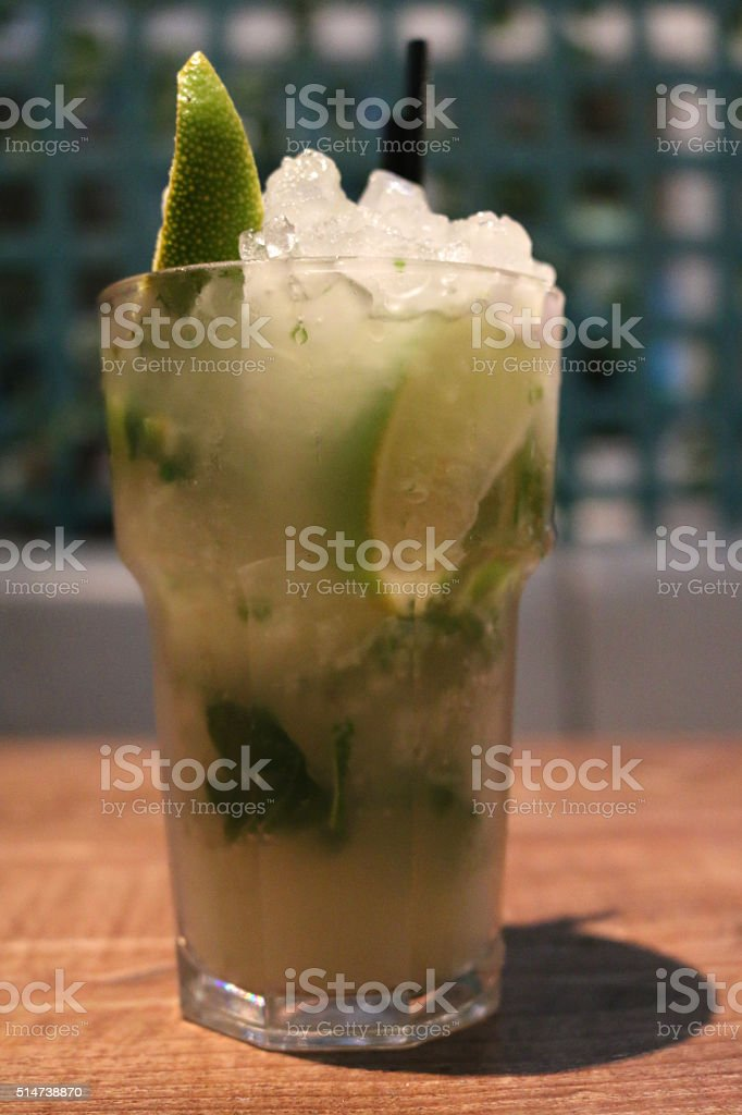 Image of mojito cocktail on bar table, alcoholic rum-based drink stock photo