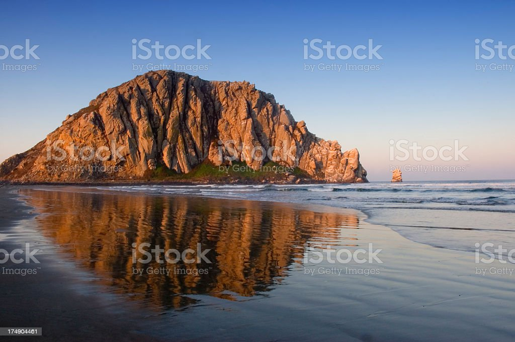 Image of Morro Rock and its reflection in water stock photo