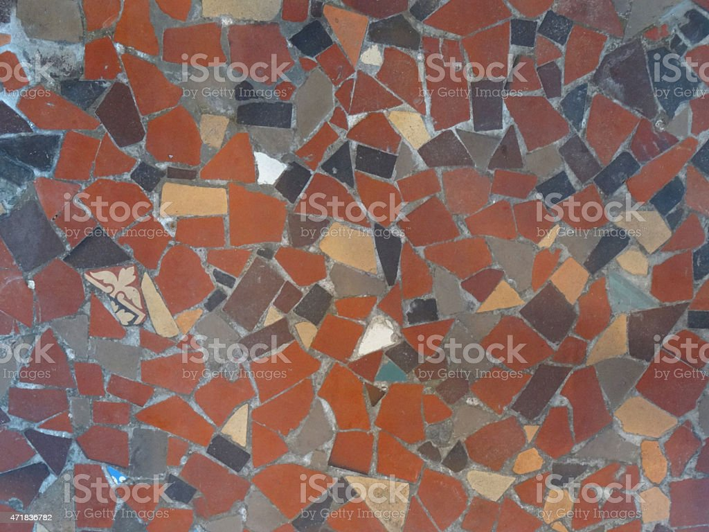 Image of mosaic floor pattern made with broken tiles, grouted stock photo