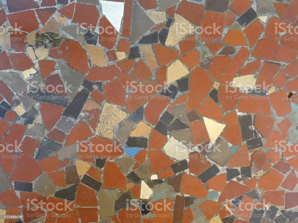 Image of mosaic floor pattern of broken terracotta tiles / collage stock photo