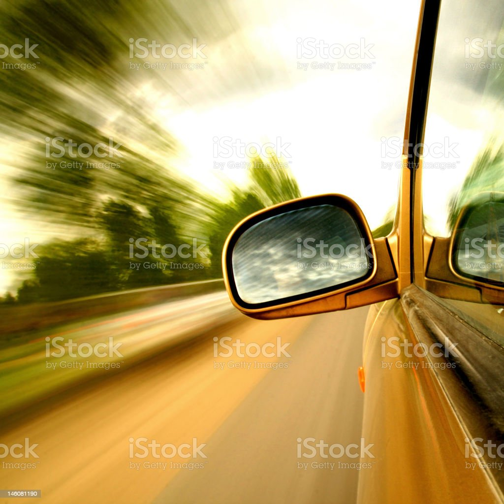 Image of movement past green trees in vehicle stock photo