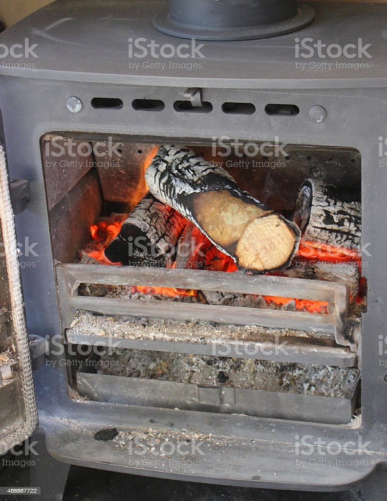 Image of multi-fuel woodburner stove fireplace, fire burning logs / wood-flames stock photo
