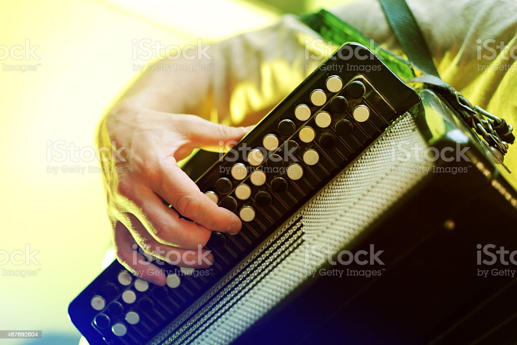 Image of musician playing on accordion closeup stock photo