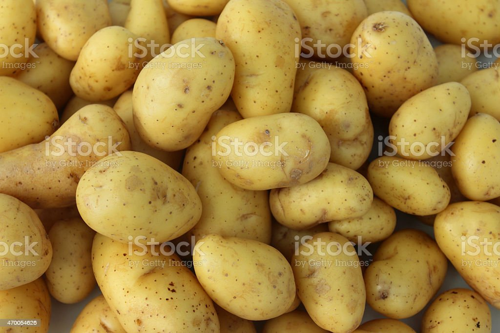Image of new potatoes, ready to boil for potato salad stock photo