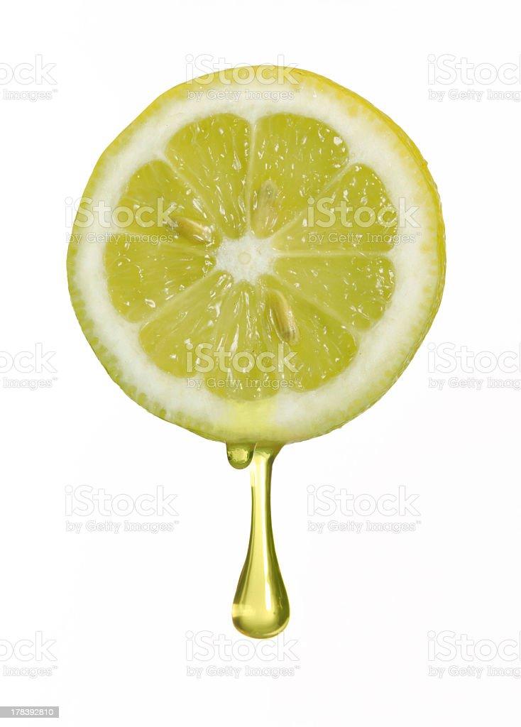 Image of one lemon slice with dripping juice stock photo