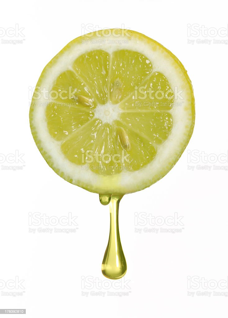 Image of one lemon slice with dripping juice stock photo