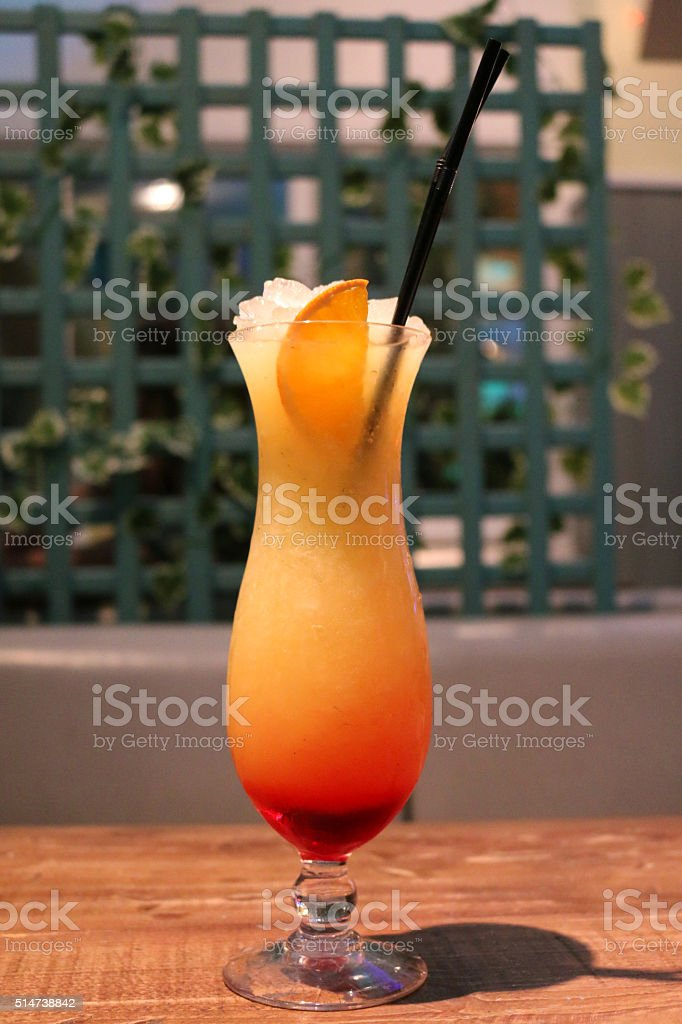 Image of orange non-alcoholic cocktail / mocktail on a bar table stock photo