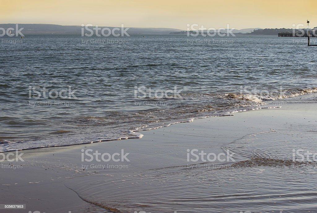 Image of orange sunset over glistening sea waves / beach / seaside stock photo