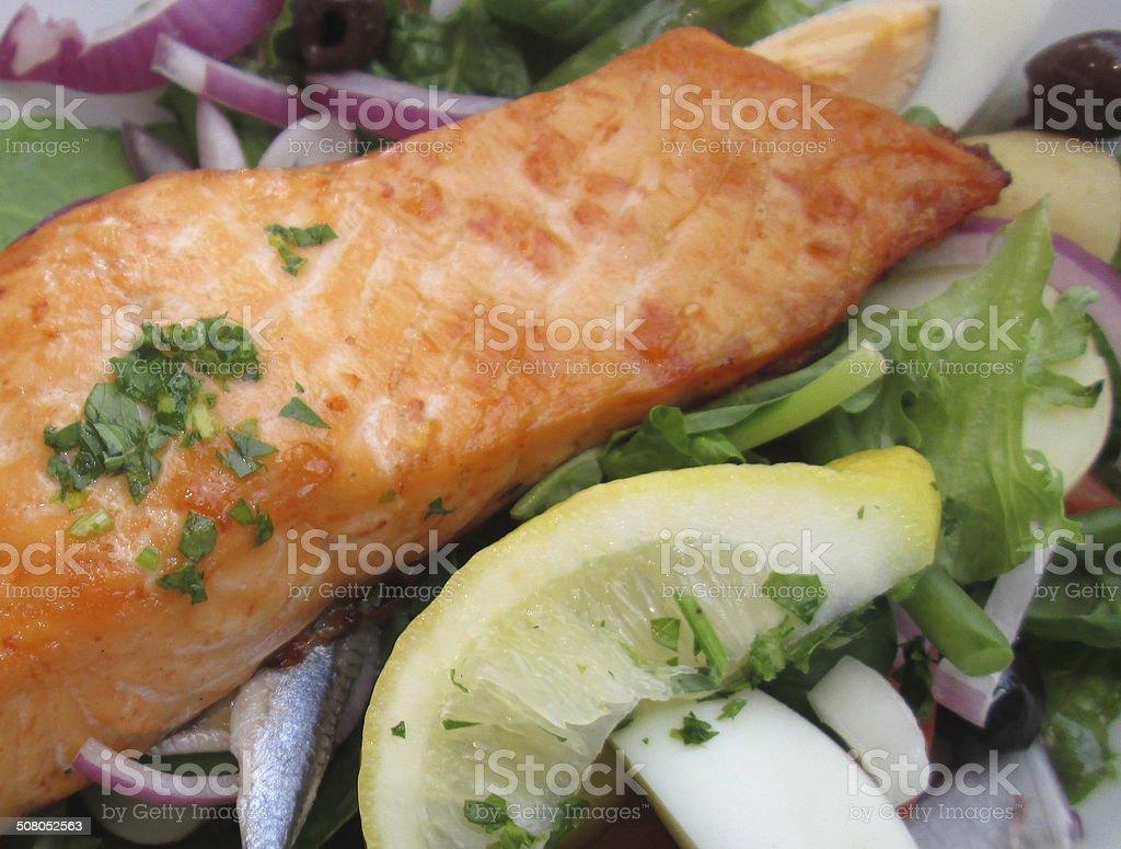 Image of pan fried salmon nicoise meal, salad, eggs, lemon royalty-free stock photo