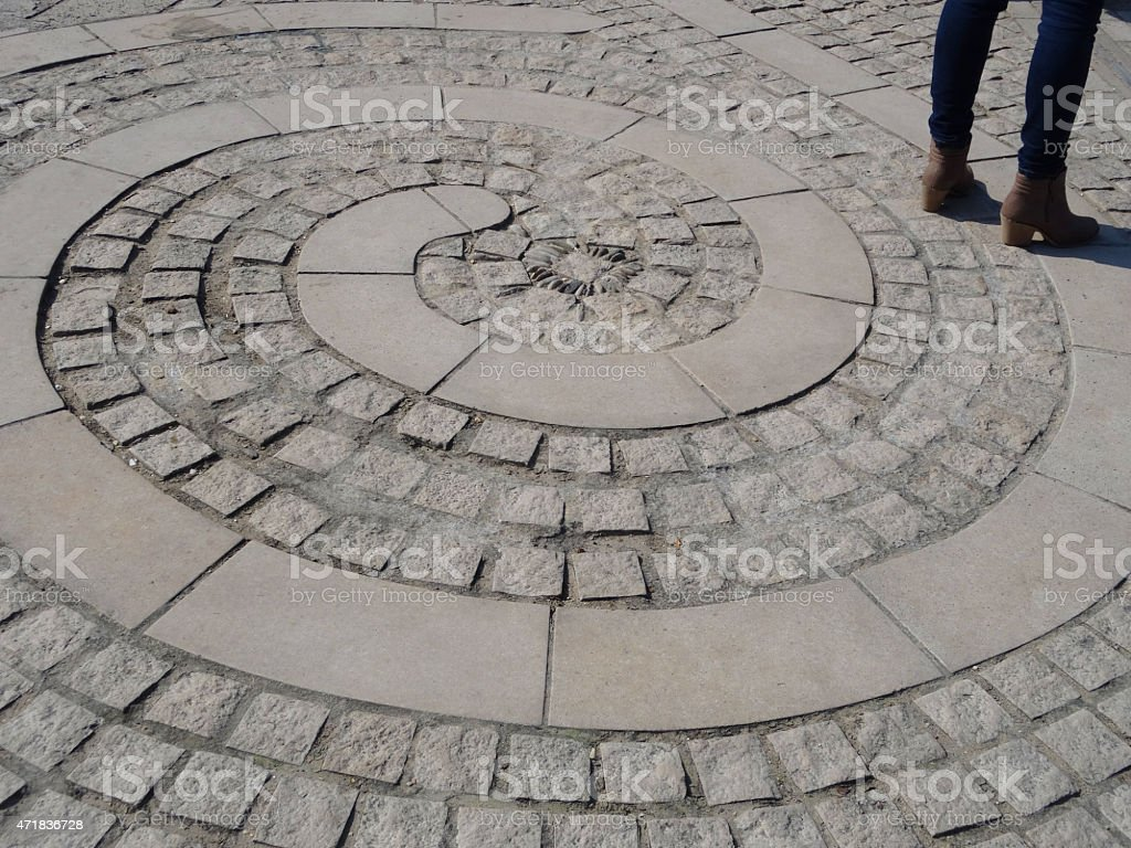 Image of paving with spirals / circles of flagstones, granite blocks stock photo