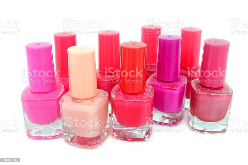 Image of pink nail varnish set / glass nail polish pots stock photo