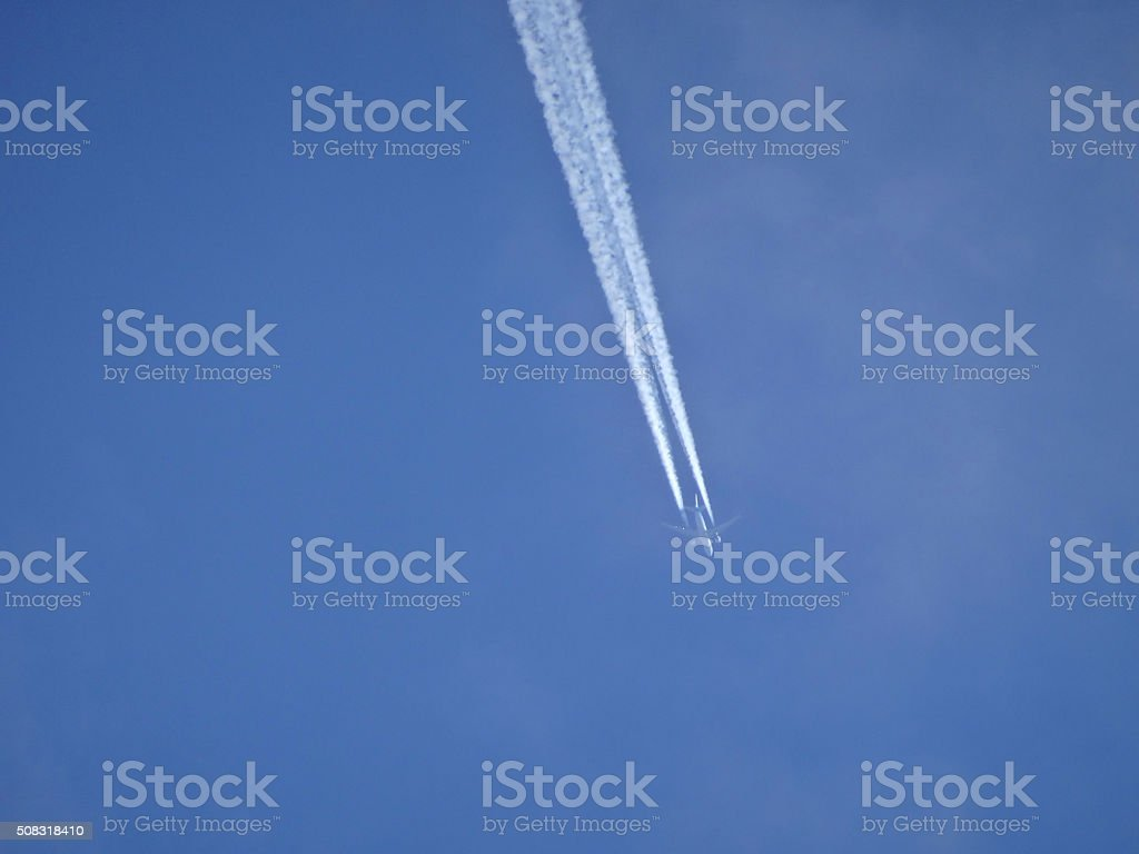 Image of plane trails in sky / trailing aircraft contrails / vapour-trails stock photo