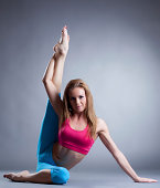Image of pretty sportswoman doing stretching