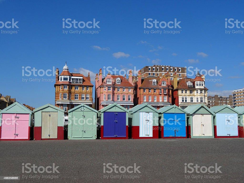 Image of rainbow coloured beach huts on Brighton seaside promenade stock photo