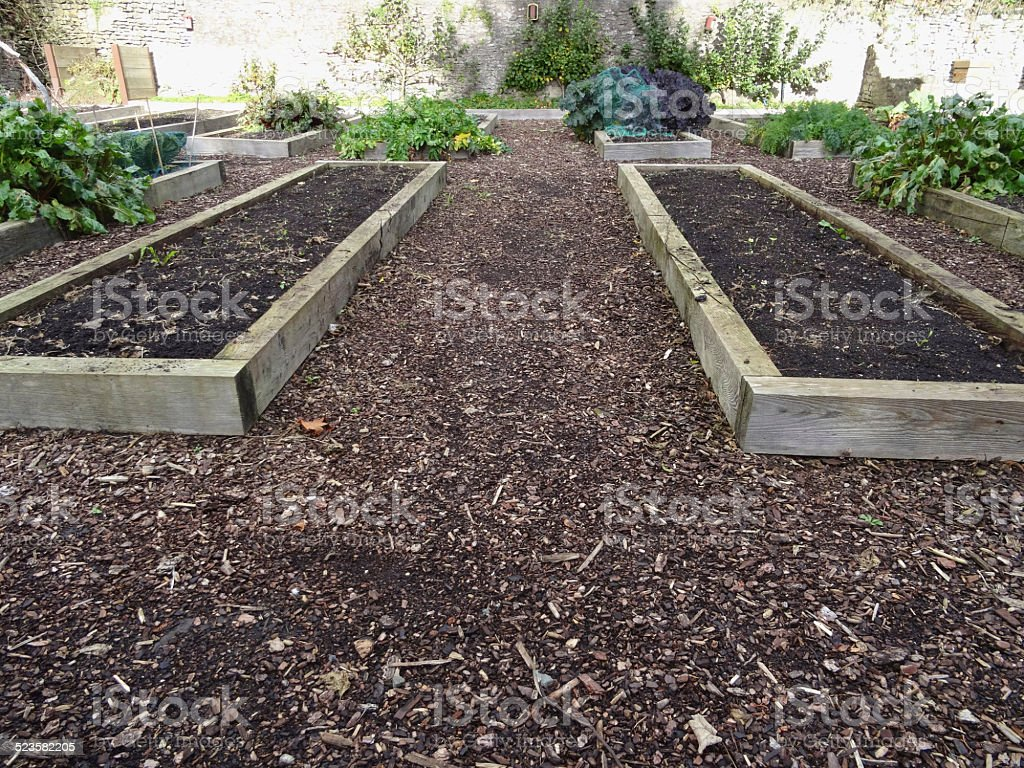 Image of raised garden beds made from wooden railway sleepers stock photo
