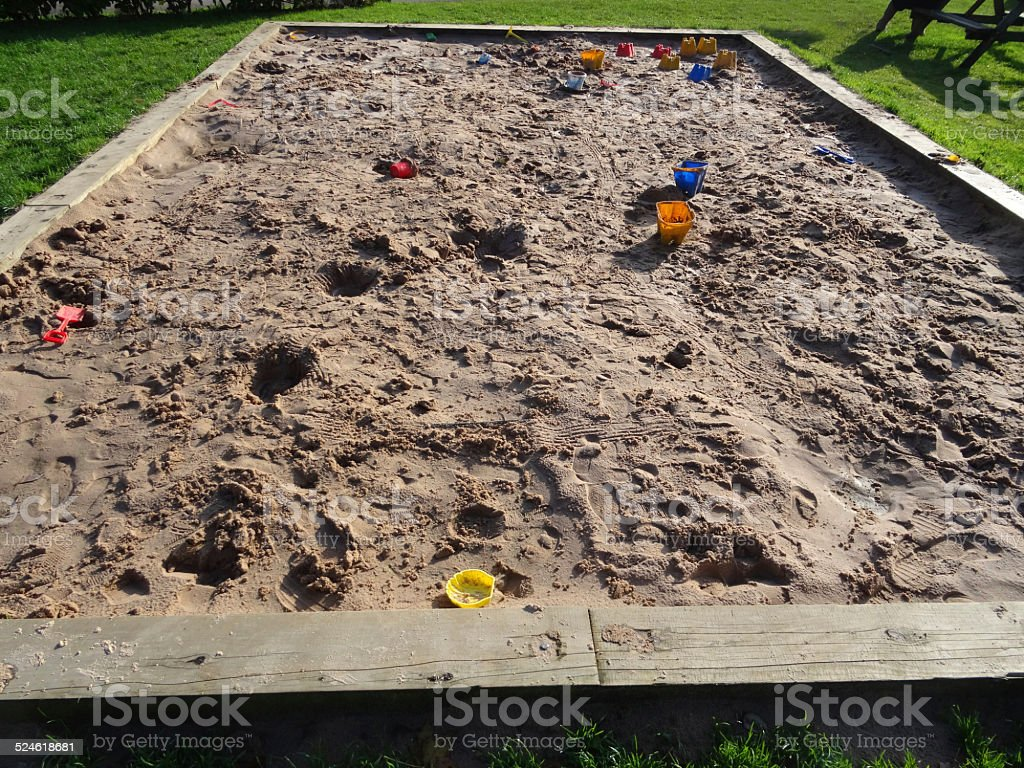 Image of raised sandpit in playground, bucket and spade, sandcastles stock photo