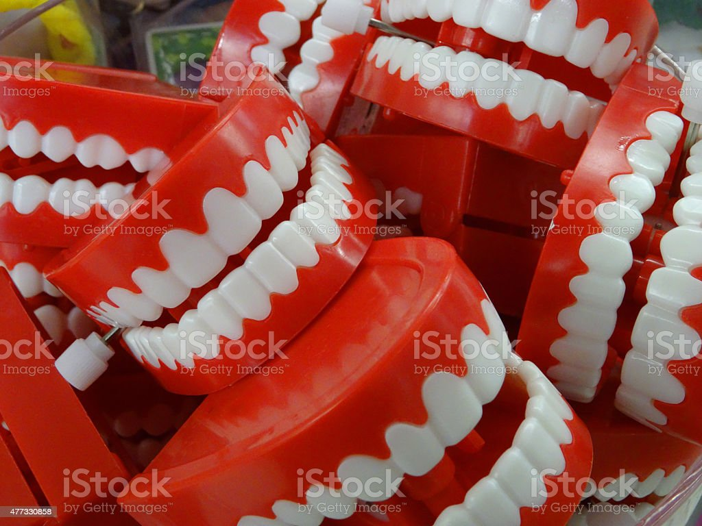 Image of red plastic wind-up chattering teeth in joke shop stock photo