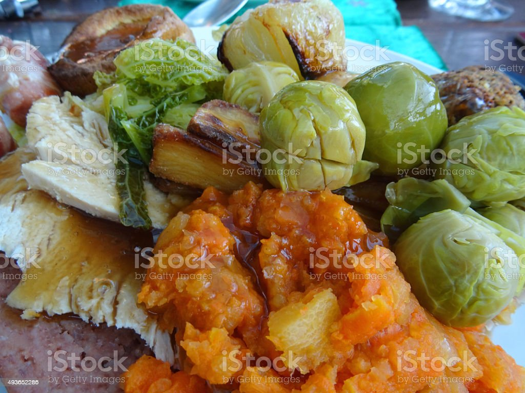 Image of roast dinner, mashed carrot / swede, sprouts, gravy, roast-onions stock photo