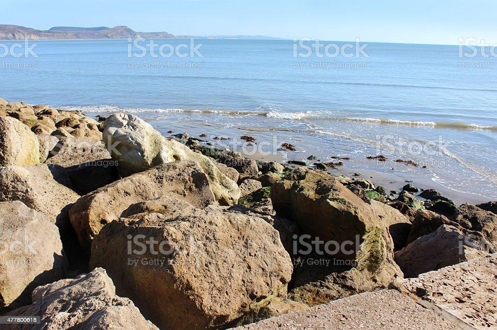 Image of rock armour sea defence on beach, preventing coastal-erosion stock photo