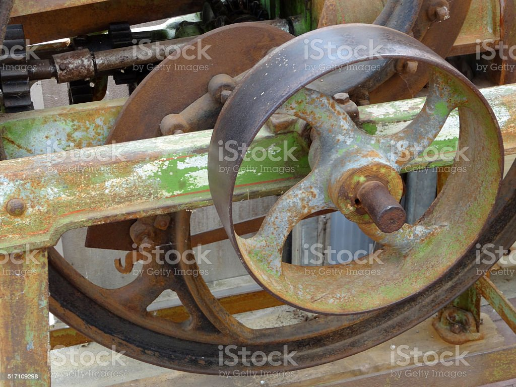 Image of rusty agricultural machinery, gears, flywheel, close up stock photo