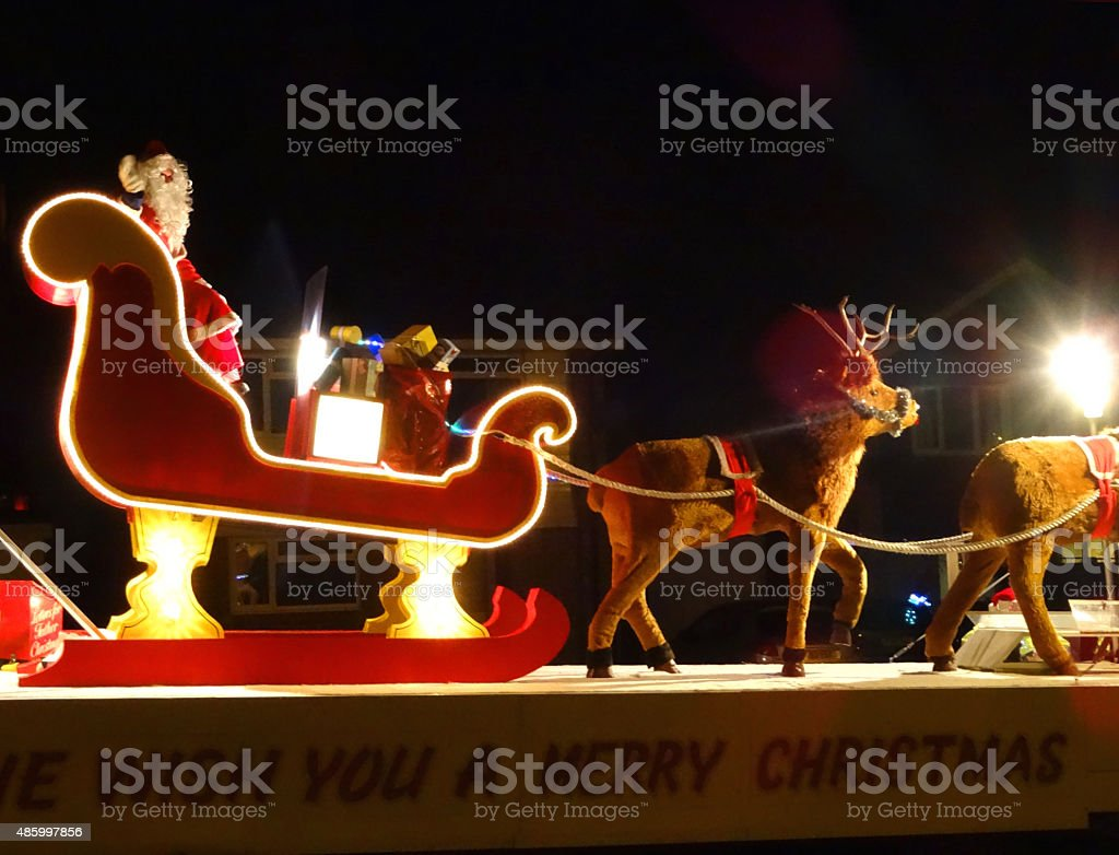 Image of Santa Claus sleigh and reindeer Christmas carnival float stock photo
