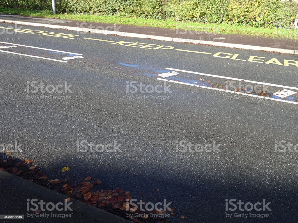 Image of school keep clear sign / zigzag lines on road stock photo