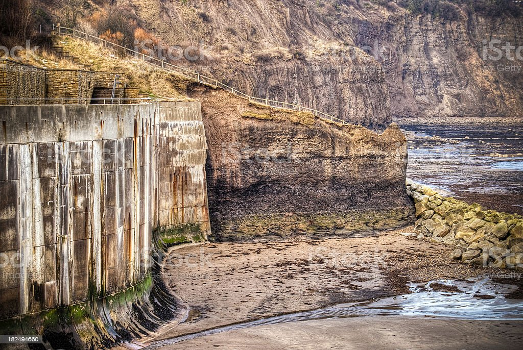 HDR image of sea wall defence and cliffs, Yorkshire, UK stock photo