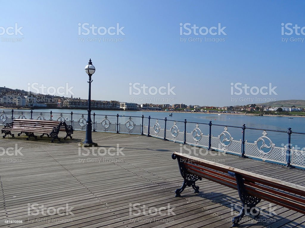 Image of seaside beach town of Swanage from wooden pier stock photo