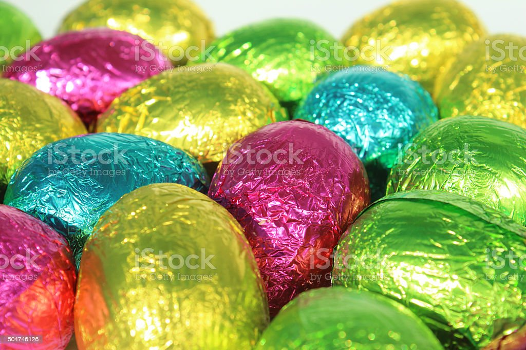 Image of shiny, multi-coloured, foil covered chocolate Easter eggs stock photo