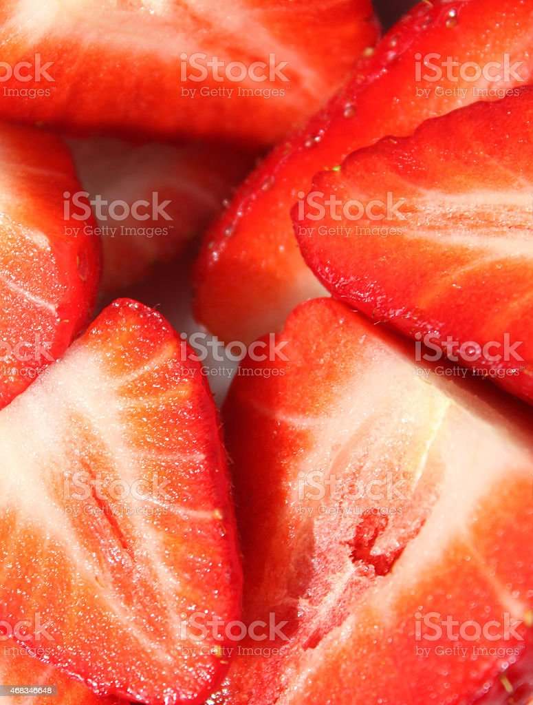 Image of sliced strawberries in halves, healthy-eating, health-benefits of fresh-fruit stock photo