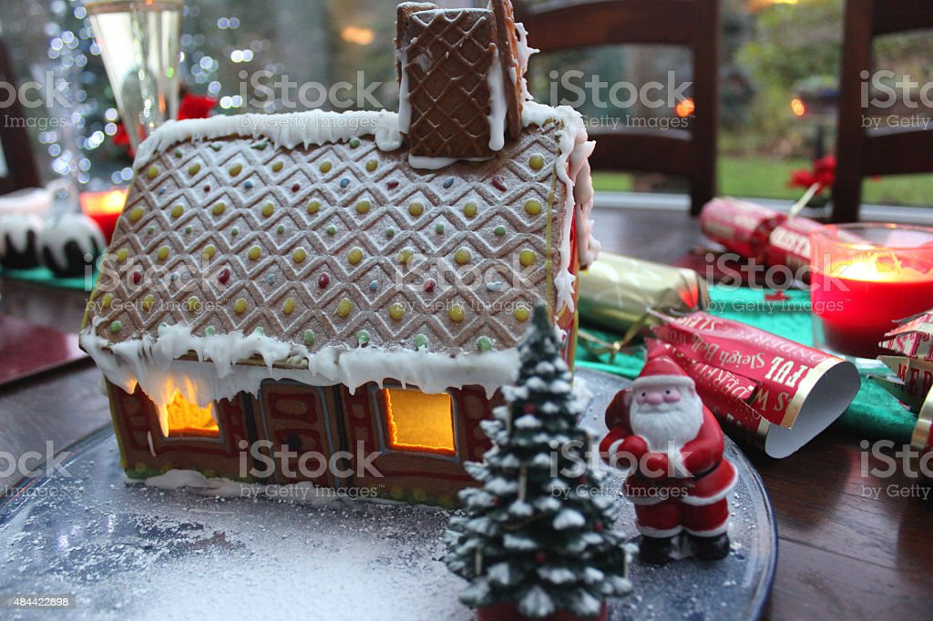 Image of small gingerbread house with Father Christmas / Santa Claus stock photo