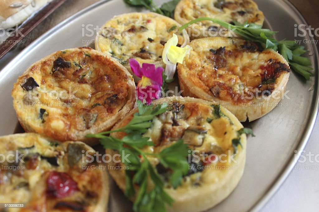Image of small mini quiches / individual quiches, party food buffet stock photo