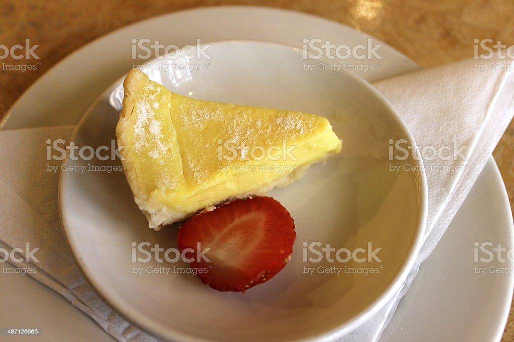 Image of small slice of lemon tart / torte, with strawberry stock photo