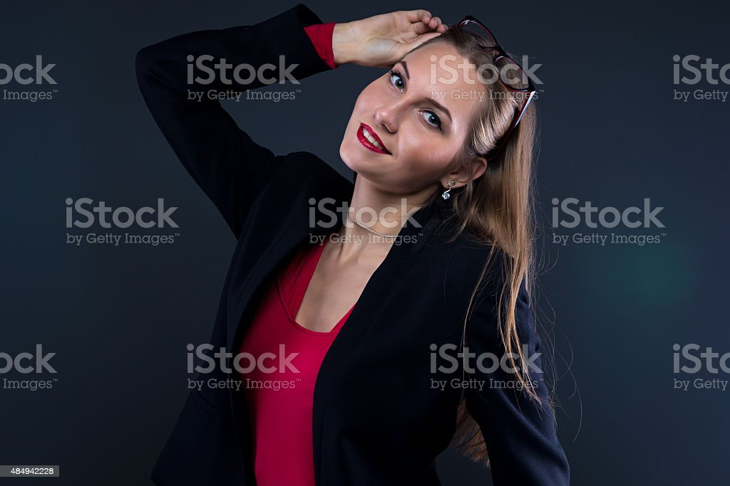 Image of smiling woman taking off glasses stock photo