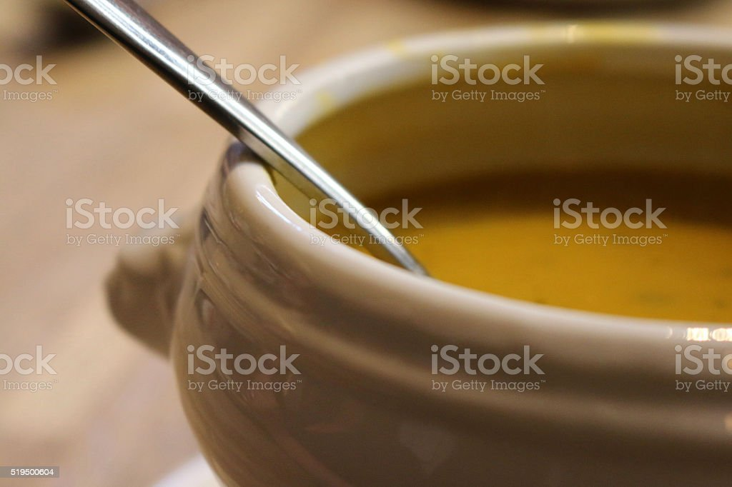Image of spoon in tureen of hot red lentil soup stock photo