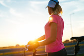 Image of sports woman with mountain bike in summer