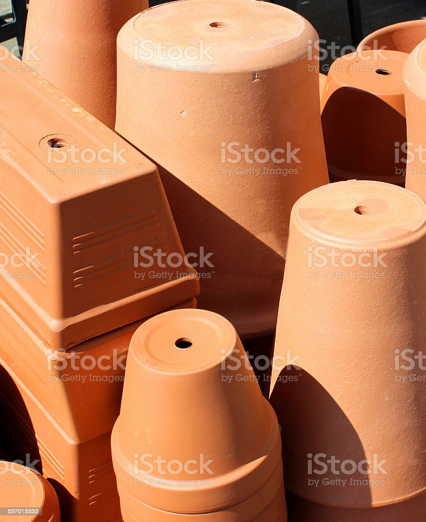 Image of stacks of large terracotta garden pots and troughs stock photo