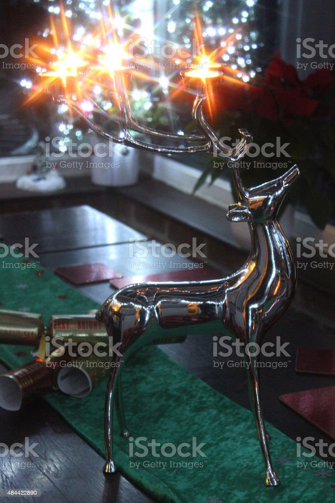 Image of stainless-steel reindeer stag with antler candle holders / tealights stock photo
