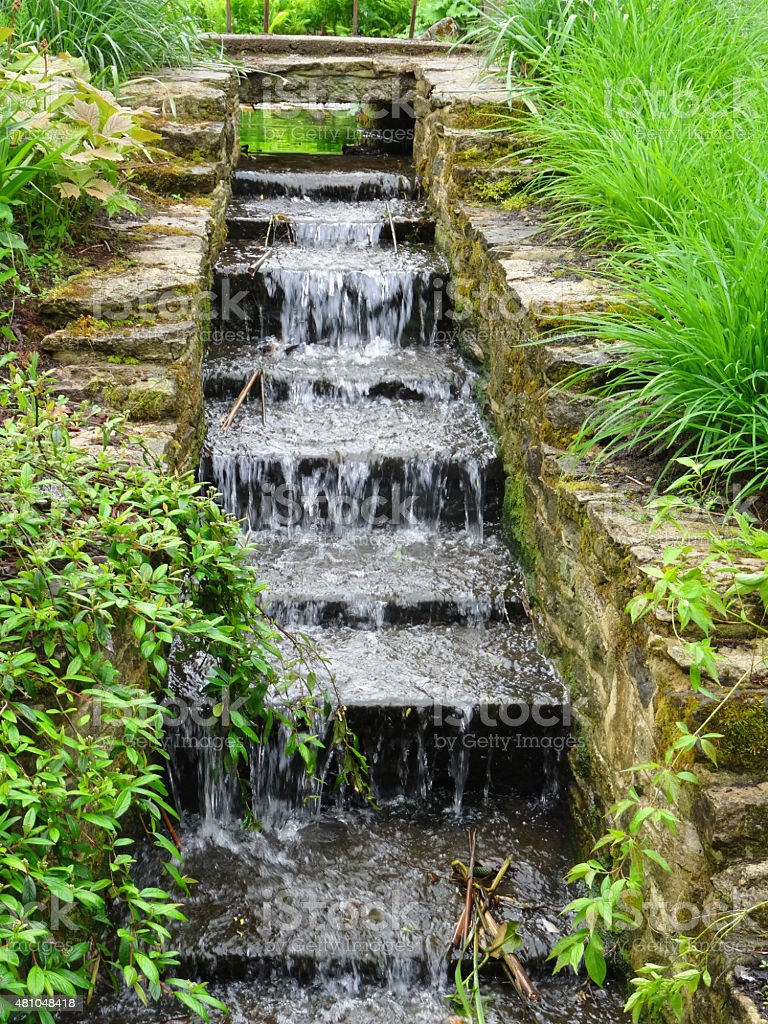 Image of staircase waterfall steps, natural garden stream water feature stock photo