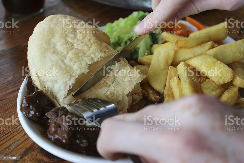 Image of steak pie, chips / fries, carrots, cabbage, gravy, puff-pastry stock photo