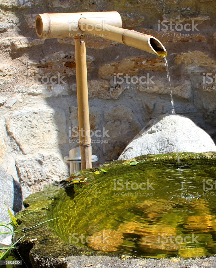 Image of stone basin / bamboo-fountain water-feature in Japanese Zen garden stock photo