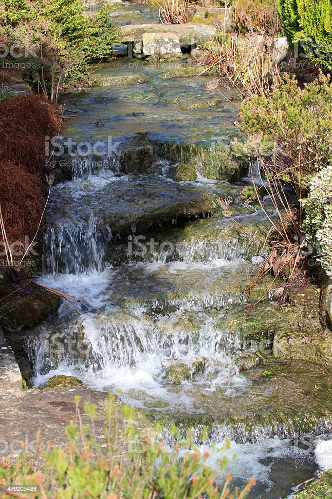 Image of stream cascade over rocks, rockery waterfall with limestone stock photo