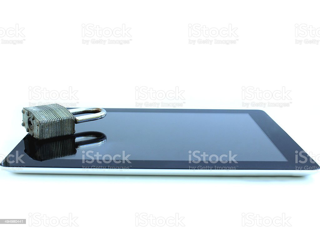 Image of tablet computer with padlock reflection on glass screen stock photo