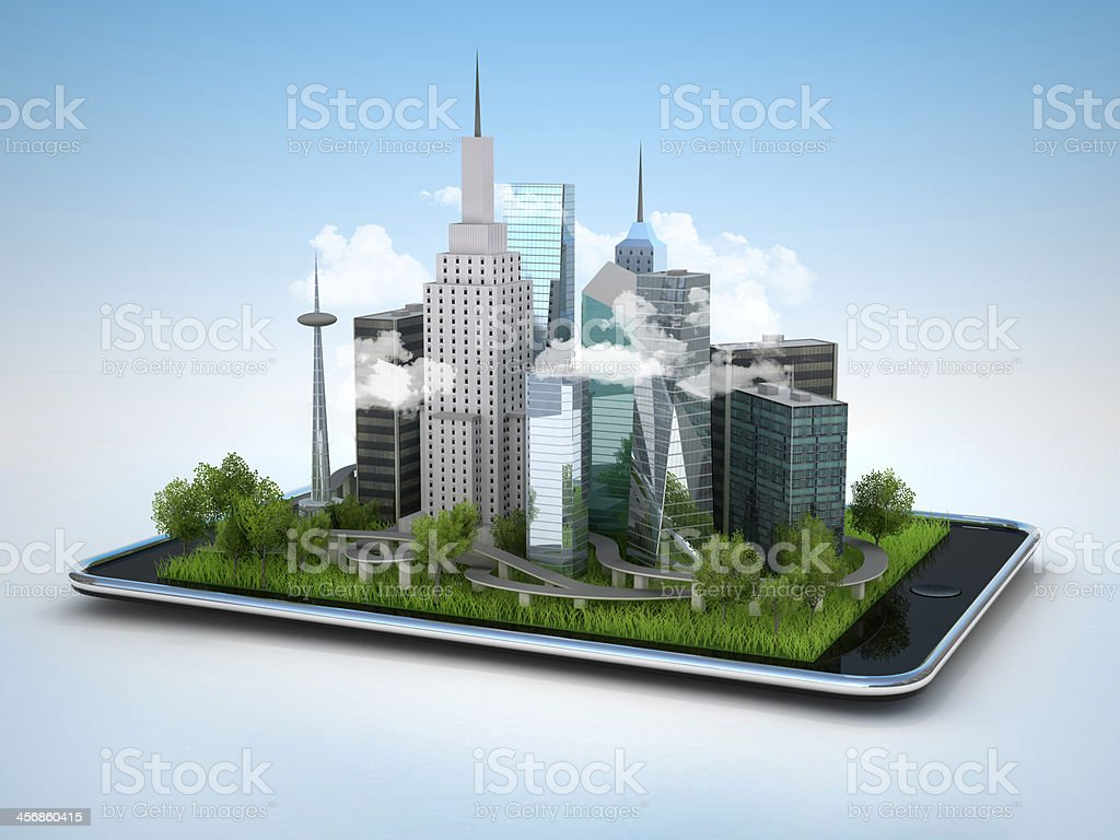Image of tablet with city stock photo